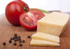 Tomatoes with fragrant pepper and cheese.  Royalty Free Stock Image