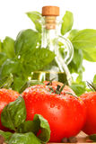 Tomatoes and fresh basil Royalty Free Stock Photography