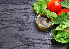 Tomatoes, fresh basil leaves and olive oil Stock Photo