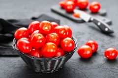 Tomatoes. Fresh tomatoes in basket on table. Closeup Stock Photos