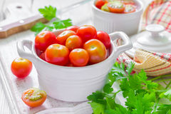 Tomatoes. Fresh cherry tomatoes with parsley Royalty Free Stock Photo