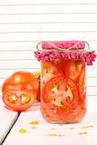 Tomatoes. Fresh cutting Tomatoes in a jar Royalty Free Stock Photography
