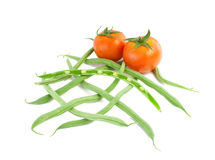 Tomatoes and fresh green beans. Tomatoes and fresh green beans Royalty Free Stock Photos