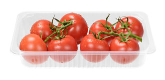Tomatoes. Fresh red vine tomatoes in tray Stock Images