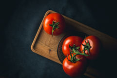 Tomatoes fresh vegetable. On dark backgraound royalty free stock photo