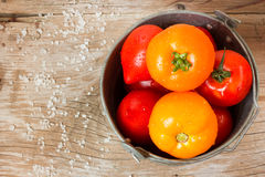Tomatoes. Fresh tomatoes on wooden table Royalty Free Stock Photography