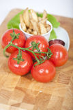 Tomatoes and fries Stock Photo