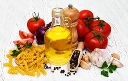 Tomatoes, fusilli, garlic and olive oil Stock Photo
