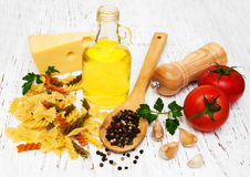 Tomatoes, fusilli, garlic and olive oil Stock Photos