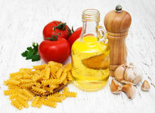 Tomatoes, fusilli, garlic and olive oil Royalty Free Stock Photos