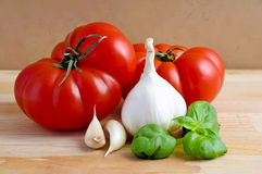 Tomatoes, garlic and basil Stock Image
