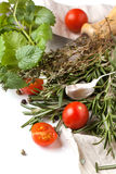 Tomatoes, garlic and herbs Royalty Free Stock Image