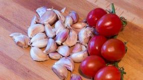 Tomatoes and garlic Stock Photos