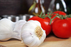 Tomatoes and garlic. Royalty Free Stock Image