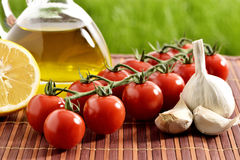 Tomatoes, garlic, lemon, tomatoes and oil Stock Photography