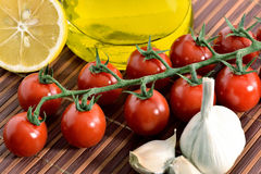 Tomatoes, garlic, lemon, tomatoes and oil Stock Images