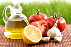 Tomatoes, garlic, lemon, tomatoes and oil Royalty Free Stock Images