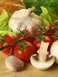 Tomatoes, garlic and mushrooms Stock Photography