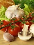 Tomatoes, garlic and mushrooms Stock Photography