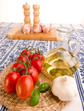 Tomatoes with garlic and oil Royalty Free Stock Image