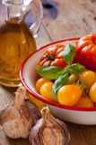 Tomatoes, garlic and olive oil Stock Image