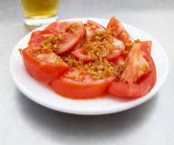 Tomatoes with garlic tapa. Tapa de tomate al ajillo. Tomatoes with garlic tapa. (Tomate al ajillo) Spanish dish Stock Photos