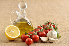 Tomatoes, garlic, tomatoes, parsley and oil Stock Images