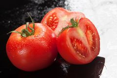 Tomatoes On A Glass Background Stock Photography