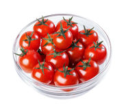 Tomatoes in a glass bowl Stock Photo
