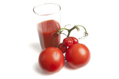 Tomatoes with a glass of fresh tomato juice Royalty Free Stock Image