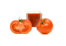 Tomatoes and a glass of juice Stock Photography