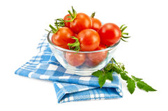Tomatoes in a glass on a napkin Stock Images
