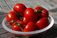Tomatoes on a glass plate. Lying on a table stock photography