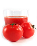 Tomatoes and a glass of tomato juice isolated Royalty Free Stock Images