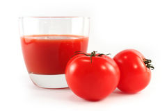 Tomatoes and a glass of tomato juice isolated Stock Image