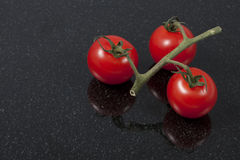 Tomatoes on a granite counter Royalty Free Stock Images
