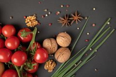 Tomatoes with Greek nuts. On grey background stock image