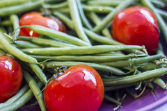 Tomatoes and Green beans. Tomatoes with fresh raw green beans Stock Images