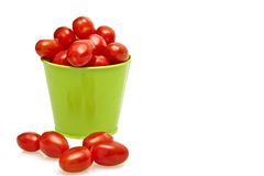 Tomatoes in a green bucket Royalty Free Stock Photography