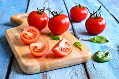 Tomatoes and green lettuce Stock Photo