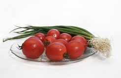 Tomatoes and green onion in a plate Stock Photo
