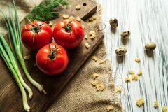 Tomatoes, green onions, dill, quail eggs on a white board 2 Royalty Free Stock Photography