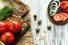 Tomatoes, green onions, dill, quail eggs on a white board 4 Stock Photos