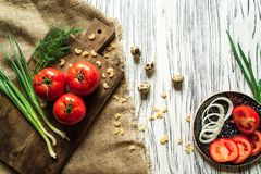 Tomatoes, green onions, dill, quail eggs on a white board 3 Royalty Free Stock Image