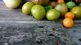 Tomatoes 43. Green and orange cherry tomatoes on wooden floor Stock Image
