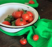 Tomatoes and green paprika in a bowl. With green towel Stock Photos