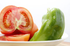 Tomatoes and green peppers Stock Photo
