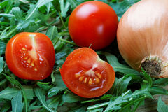 Tomatoes and green salad Royalty Free Stock Photo