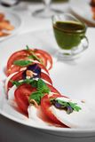 Tomatoes with green sauce Stock Image