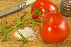 Tomatoes with green Stock Image